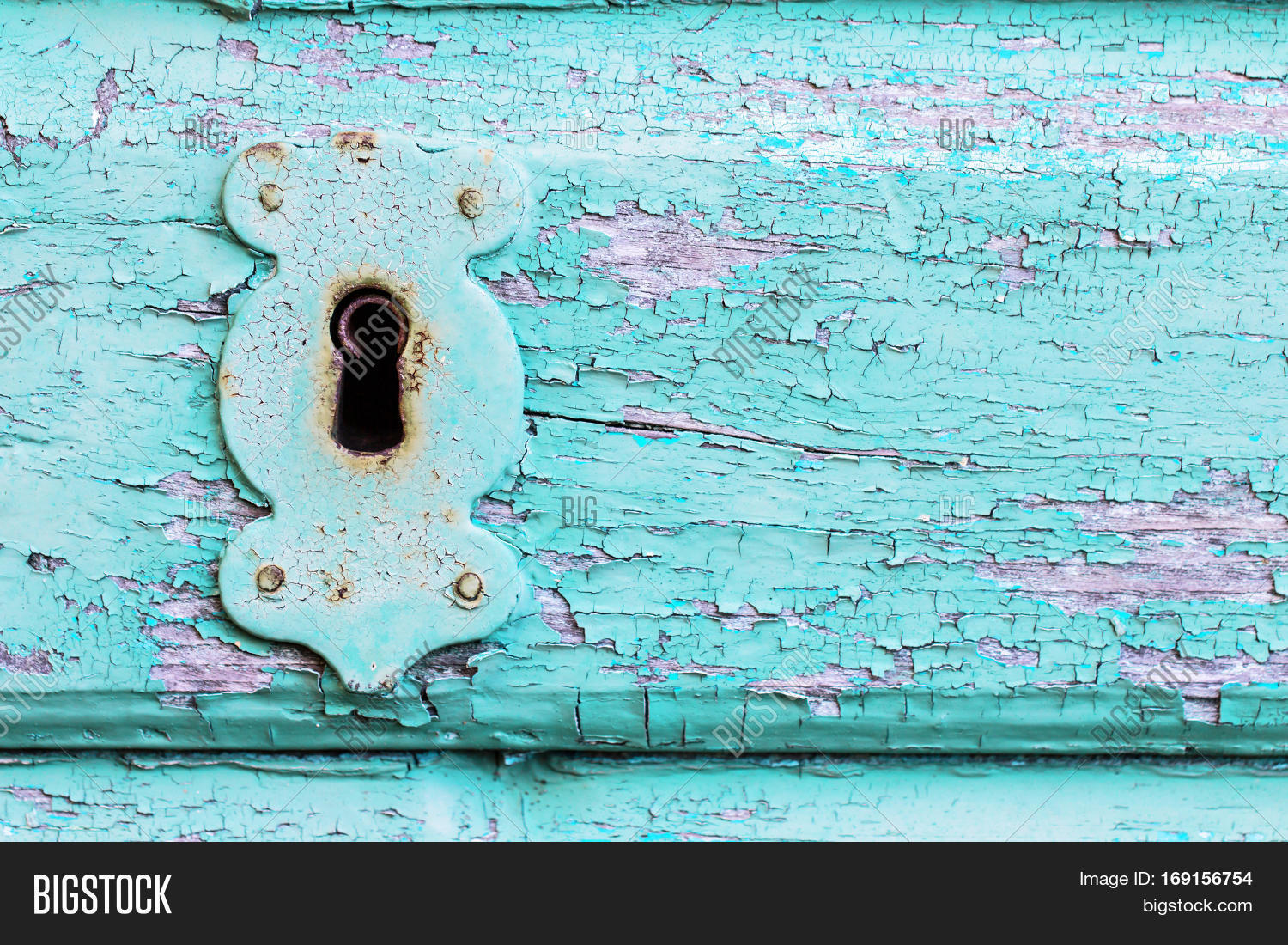 Beautiful Old Vintage Rustic Cracked Turquoise Paint Wooden Door And Rusty Iron Lock Keyhole As