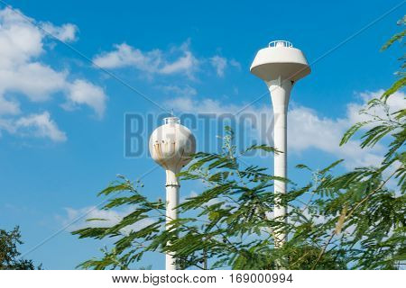 Two outdoor water towers structure under bluesky