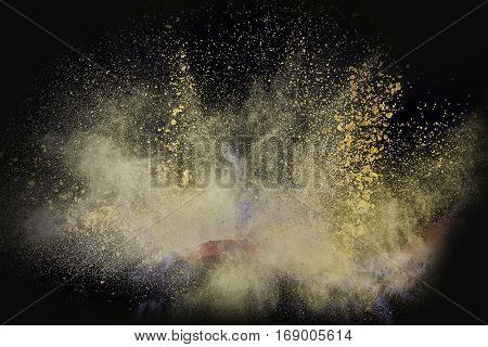 Color powder exploded, isolated on control environment.