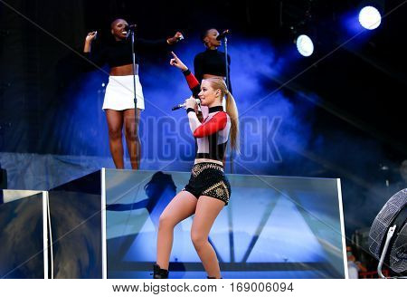 LAS VEGAS-SEP 20: Rapper Iggy Azalea performs in concert at the 2014 iHeartRadio Music Festival Village Show at MGM Resorts Village on September 20, 2014 in Las Vegas, Nevada.