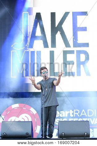 LAS VEGAS-SEP 20: Rapper/songwriter Jake Miller performs in concert at the 2014 iHeartRadio Music Festival Village Show at MGM Resorts Village on September 20, 2014 in Las Vegas, Nevada.