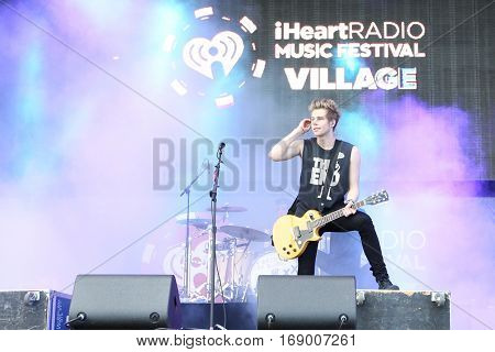 LAS VEGAS-SEP 20: Singer Luke Hemmings of 5 Seconds of Summer performs in concert at the 2014 iHeartRadio Music Festival Village Show at MGM Resorts Village on September 20, 2014 in Las Vegas, Nevada.