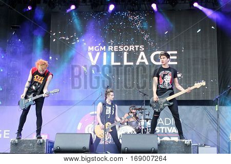 LAS VEGAS-SEP 20: (L-R) Michael Clifford, Luke Hemmings, Ashton Irwin and Calum Hood of 5 Seconds of Summer perform at the 2014 iHeartRadio Music Festival on September 20, 2014 in Las Vegas, Nevada.