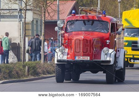ALTENTREPTOW / GERMANY - MAY 1 2016: german mercedes benz fire truck oldtimer drives on a street at oldtimer show on may 1 2016 in altentreptow germany.