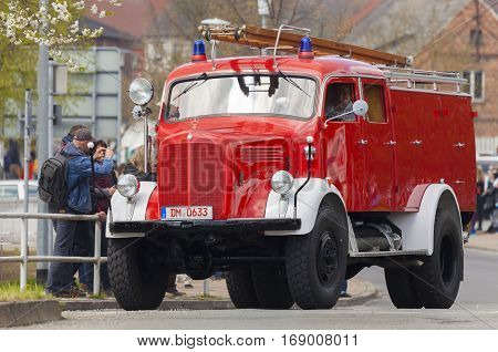 ALTENTREPTOW / GERMANY - MAY 1 2015: german mercedes benz fire truck oldtimer drives on a street at oldtimer show on may 1 2015 in altentreptow germany.