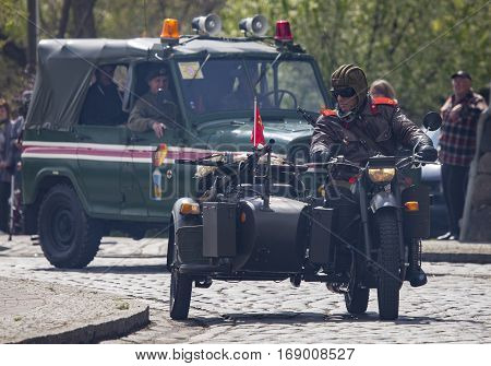 ALTENTREPTOW / GERMANY - MAY 1 2015: soviet heavy motorcycle dnepr k 750 with sidecar drives on a street at oldtimer show on may 1 2015 in altentreptow germany.