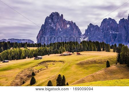 The  Dolomites - World Natural Heritage. Well-known international ski resort in the fall. Jagged rocks around the Alps di Siusi mountain valley. Concept of active and ecological tourism