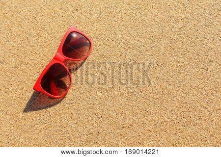 Red sun glasses on the beach in Thailand