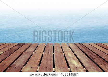 Landscape of blue sea background with wooden floor