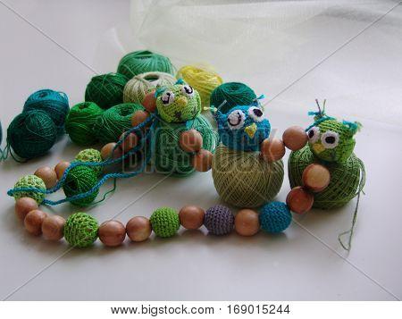 Basket. Greenish yarn. Colored balls of yarn. Valentine. All colors.