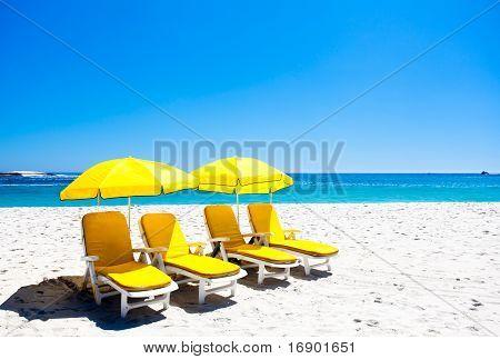 Four Yellow Beach Chairs