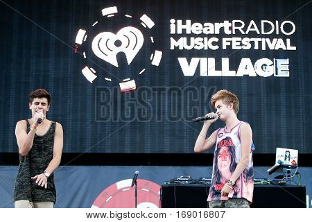 LAS VEGAS-SEP 20: Viners Jack Gilinsky (L) and Jack Johnson on stage at the 2014 iHeartRadio Music Festival Village Show at MGM Resorts Village on September 20, 2014 in Las Vegas, Nevada.