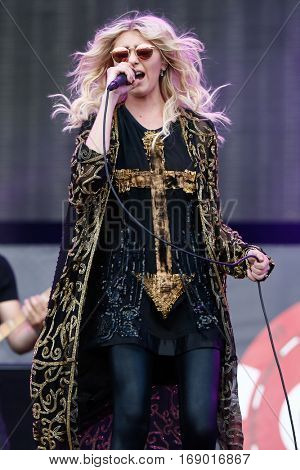 LAS VEGAS-SEP 20: Singer Taylor Momsen of The Pretty Reckless performs in concert at the iHeartRadio Music Festival Village Show at MGM Resorts Village on September 20, 2014 in Las Vegas, Nevada.