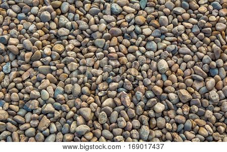 Different color stones pebbles for background texture.