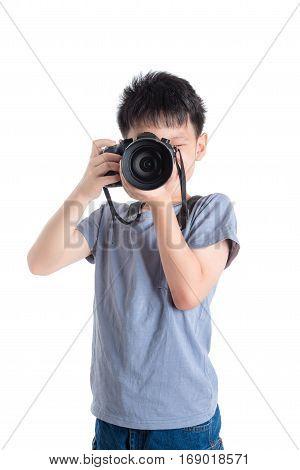 Little photographer taking photo over white background