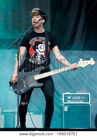 LAS VEGAS-SEP 20: Musician Calum Hood of 5 Seconds of Summer performs at the 2014 iHeartRadio Music Festival Village Show at MGM Resorts Village on September 20, 2014 in Las Vegas, Nevada.