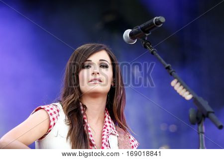 LAS VEGAS-SEP 20: Country music singer Kacey Musgraves performs in concert at the 2014 iHeartRadio Music Festival Village Show at MGM Resorts Village on September 20, 2014 in Las Vegas, Nevada.