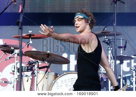 LAS VEGAS-SEP 20: Drummer Ashton Irwin of 5 Seconds to Summer performs in concert at the 2014 iHeartRadio Music Festival Village Show at MGM Resorts Village on September 20, 2014 in Las Vegas, Nevada.