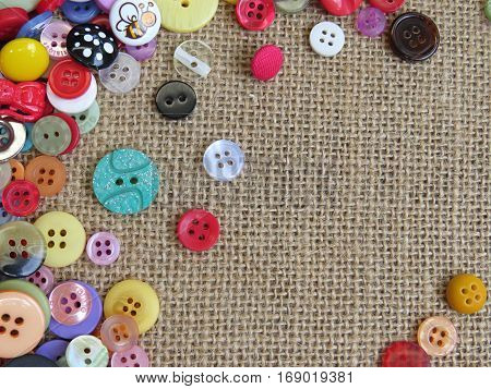 Bright buttons on a hessian burlap background