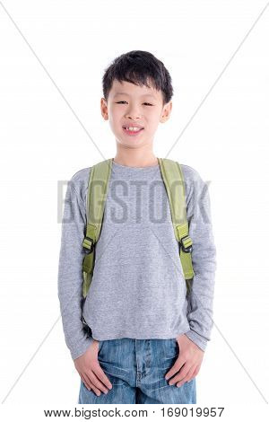 Young asian schoolboy with backpack over white background