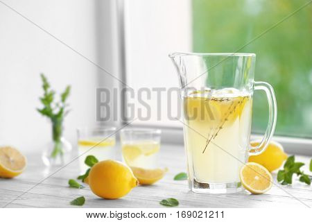 Cold fresh lemonade on windowsill