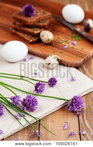 Organic rye bread with fresh chives and eggs selective focus