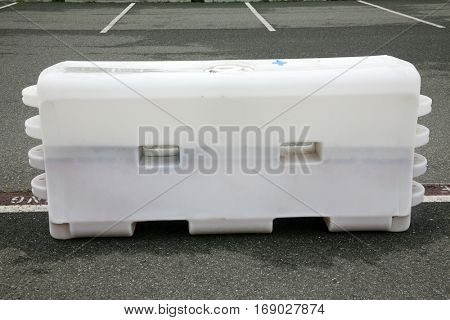 Plastic Molded Parking Control Barrier outdoor in a parking lot. Parking Control. Traffic Flow. Traffic Control.