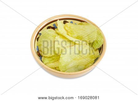 Potato chip flavored wasabi in the ceramic bowl on a light background
