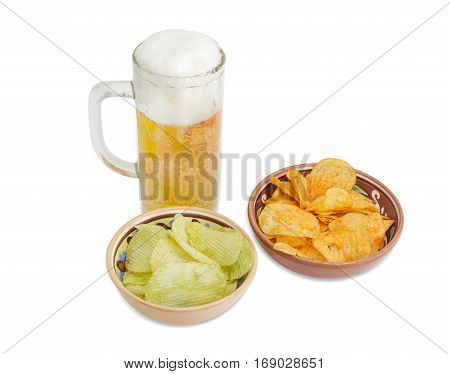 Beer glassware with lager beer potato chip flavored paprika and wasabi in two different ceramic bowls on a light background