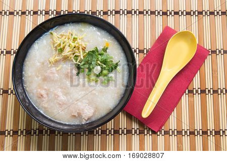Congee Rice porridge Rice gruel Rice soup on wooden background Top view.