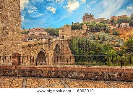 View of old historical city Toledo with Alcantara bridge. Toledo Spain