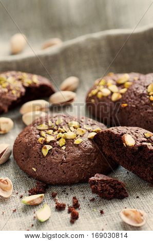 Homemade chocolate cookies with pistachios selective focus toned