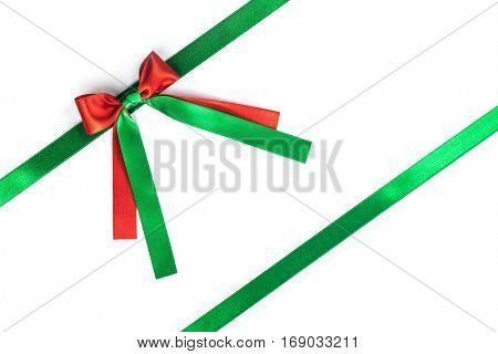 Red and green ribbon bow isolated on white background