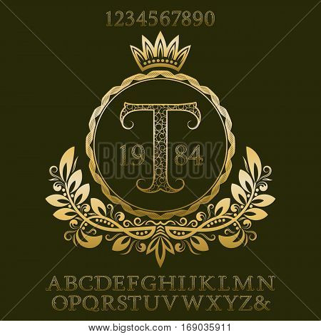 Golden patterned letters and numbers with initial monogram in coat of arms form. Elegant font and elements kit for logo design.