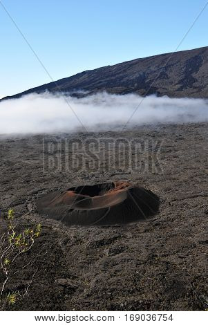 Little Crater in the Old Caldera of the Peak of The Furnace with a blue sky