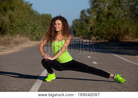 Young, Attractive, Athletic Girl In Black-green Tracksuit Doing Morning Sports Training In The Park.