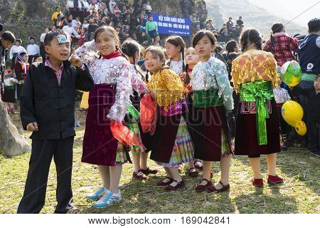 Ha Giang, Vietnam - Feb 7, 2014: Unidentified group of children wearing Hmong traditional new year clothe, waiting for their dancing perform in a mountainous festival in Pho Cao, Ha Giang, Vietnam