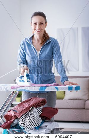 Woman Ironing At Home