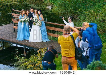 RADZIVILKI, BELARUS - OCT 10: Photographers shoot the groomsmen and bridesmaids at the wedding workshop at October 10, 2016 in Radzivilki, Belarus