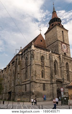 Brasov,Transylvania,Romania - September 22 2016 : Tourist walk along side the famous gothic style monument known as