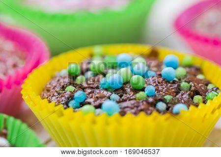 Colourful vertigo: sweet muffins in different colors