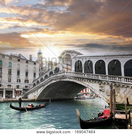 Venice Rialto bridge and with gondola on Grand Canal Italy