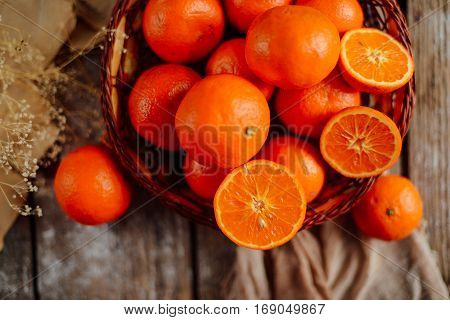 Basket Of Tangerines On A Wooden Table.  Delicious And Beautiful