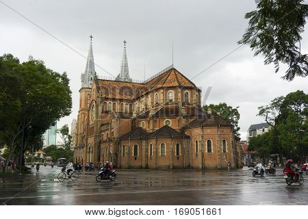 Ho Chi Minh, Vietnam - June 22, 2014: Transportation on a Ho Chi Minh street in the rain in Ho Chi Minh city, Vietnam