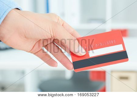 Hands of business woman holding credit card. Shopping, consumerism, delivery or internet banking concept. Anti-fraud and financial security concept