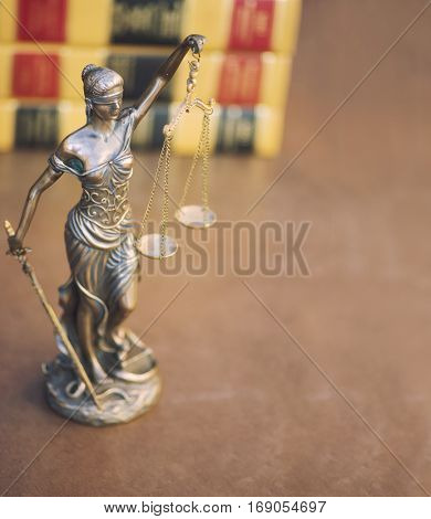 Legal law concept image  - scales of justice and books