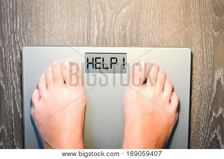 Help to lose kilograms with woman feet stepping on a weight scale