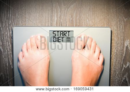Lose weight concept with person on a scale measuring kilograms poster