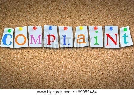 Complaint word suggesting customer support on cork panel