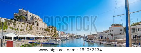 Cuitadella old town port on sunny summer day, Menorca island, Spain.